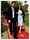 (c)Reuters - Ashton Kutcher and Demi Moore on their way to the conference in Luxor