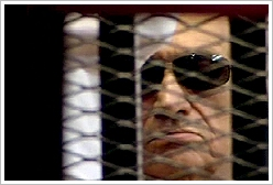 Mubarak in court room, image taken from Egyptian state TV